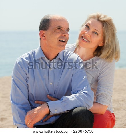 aged  couple spending time together in bathing-place - stock photo
