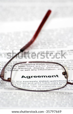 """Agreement"" word focused thought glasses - stock photo"