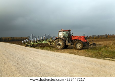 agricultural field, which is processed by a tractor. plowed