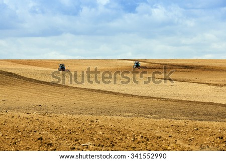 agricultural field, which is the springtime tractor plowed for sowing crops
