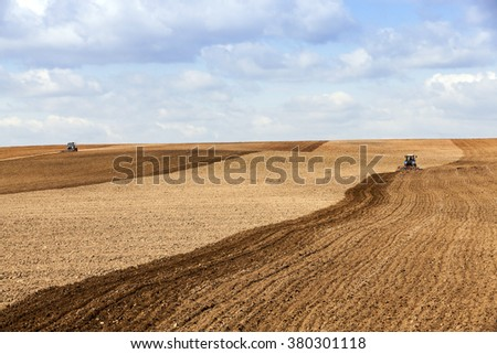 agricultural field, which is the springtime tractor plowed for sowing crops - stock photo