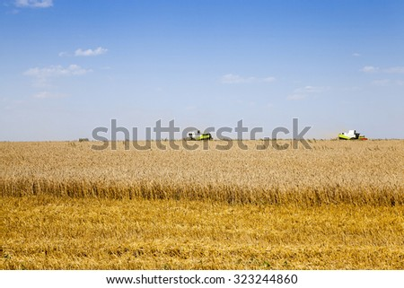agricultural field, which made the cereal harvest. Harvester in the field - stock photo