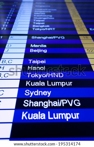 Airport arrival board in airport terminal. Travel concept. - stock photo