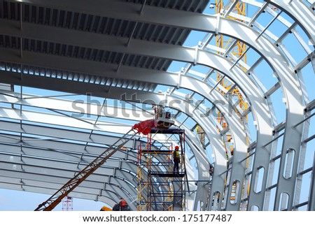 Airport construction in the middle stage. Frame, construction, design. The metal structure. To build a building. Industrial. The construction of the airport terminal. The construction works.