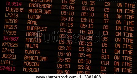 Airport Schedule board showing flight status and gate numbers