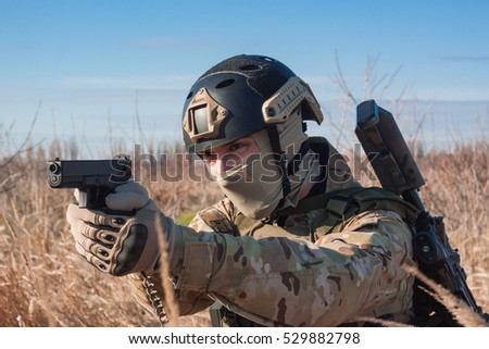 airsoft soldier posing with pistol