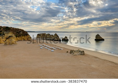 Algarve best spots, famous Praia Dona Ana beach with turquoise sea water and cliffs. Landscape at Sunrise int an idyllic beach, in Lagos. Amazing seascape in Portugal. - stock photo