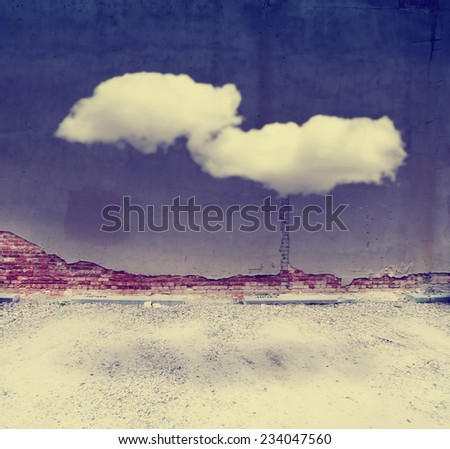 alleyway building and wall with a cloud floating in front toned with a retro vintage instagram filter  - stock photo