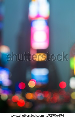 An abstract blur view of Times Square in New York City. - stock photo