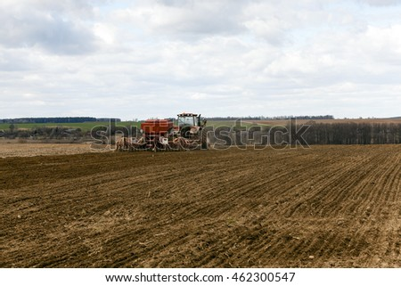 an agricultural field, which made planting wheat seeds of a new crop of grain