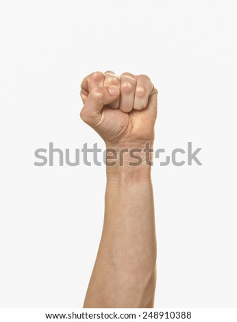 An arm extended with a clenched fist. - stock photo