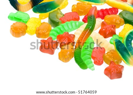 An assortment of colorful  jelly candy, border isolated on white - stock photo