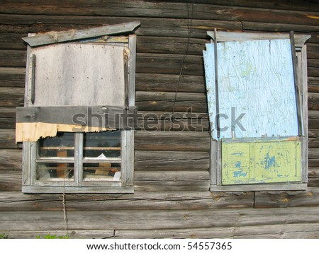 An old boarded-up window - stock photo