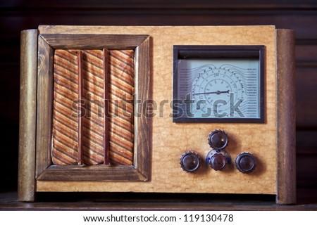 an old radio with knobs for adjusting the volume and the channels - stock photo