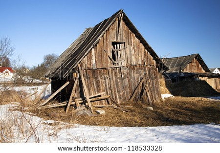 an old wooden shed which started to fall sideways. Belarus - stock photo