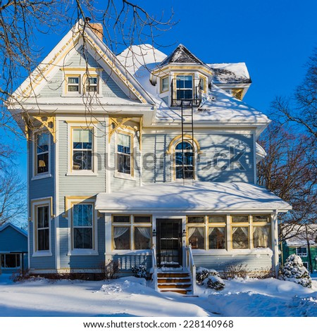 An older north American home after a snow storm. - stock photo