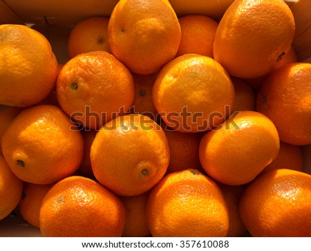 An overhead view of many delicious clementines. - stock photo