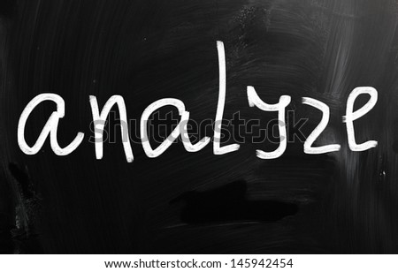 """Analyze"" handwritten with white chalk on a blackboard - stock photo"