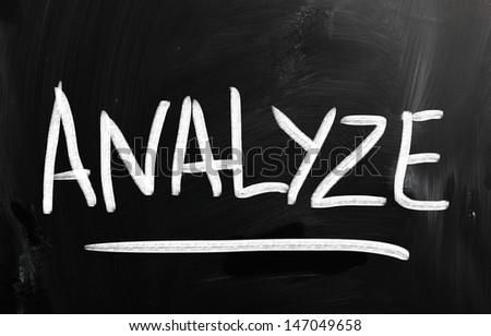 """Analyze"" handwritten with white chalk on a blackboard. - stock photo"