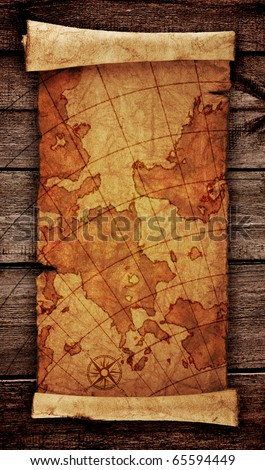 ancient scroll map, on the old wooden background - stock photo