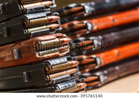 7.62 and 5.56 ammo for machine guns with loaded magazines 7.62 ammo for machine guns with loaded magazines on table