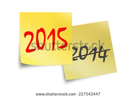 2015 and 2014 text written on yellow sticky notes isolated on white background