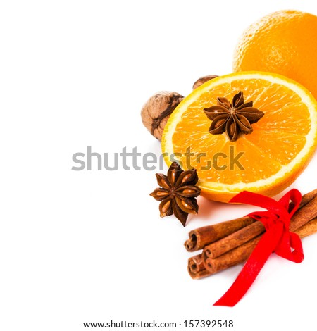 Anise star, Cinnamon stick and fresh orange, Christmas spices for hot mulled wine isolated on white background, closeup.  - stock photo