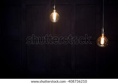 antique edison style light bulbs against wall  - stock photo