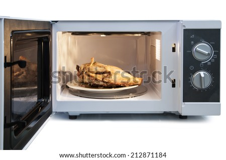 Appetizing roast chicken in the oven  - stock photo
