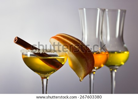 apple liquor with cinnamon on a grey background