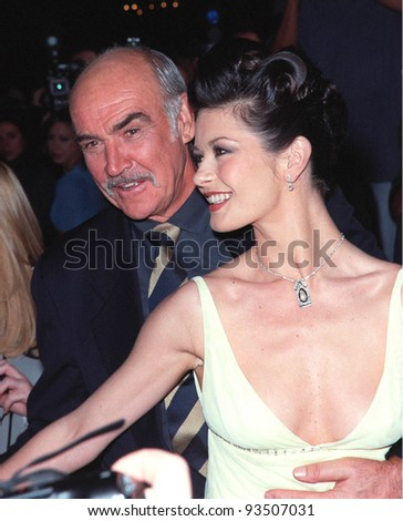 """15APR99:  Actor SEAN CONNERY & actress CATHERINE ZETA JONES at the Hollywood premiere of their new movie """"Entrapment.""""  Paul Smith / Featureflash - stock photo"""
