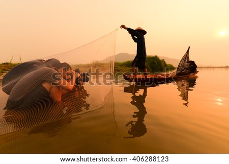 10-Apr-2016 Nongkhai, Thailand This is behind the scene of photographer group is making picture of fishing process in Mekong river in the morning.
