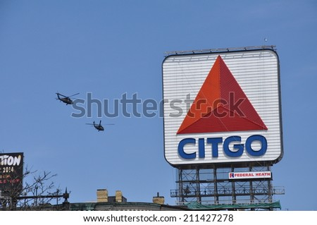 21 April - Boston, MA: Helicopters fly past Boston's iconic Citgo sign near Fenway Park as part of security during the running of the 2014 Boston Marathon.