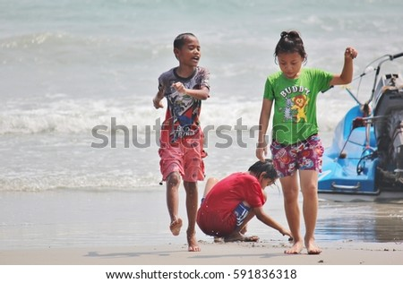 14 April 2016 Children play in the water at Laem Mae Phim, Rayong, Thailand
