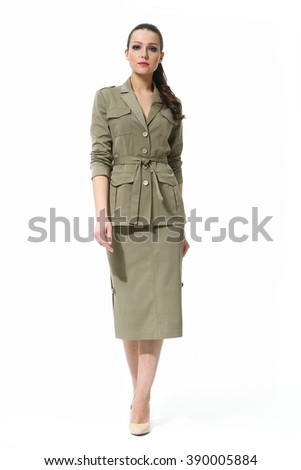 arabian asian eastern brunette business executive woman with straight hair style in printed ethnic summer long safari suit high heel shoes standing full body length isolated on white - stock photo