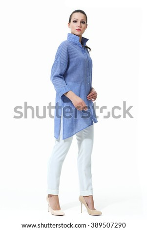 arabian asian eastern brunette business executive woman with straight hair style in summer baggy blue shirt and white jeans high heel shoes standing full body length isolated on white - stock photo