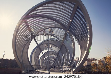 Arganzuela Bridge in Madrid Rio Park, Madrid, Spain.  Designed by Dominique Perrault, it is 274 metres in length and formed by two spiral-shaped walkways  - stock photo