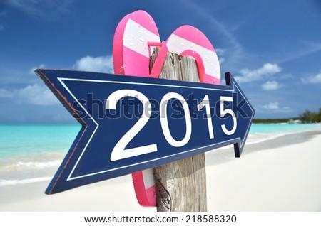 2015 arrow on the beach - stock photo