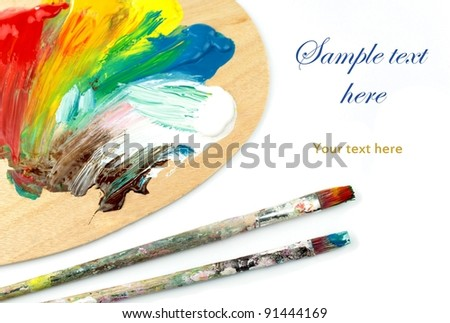 Artist palette , colors and paintbrushes - stock photo