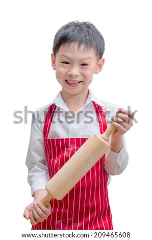 Asian boy chef showing rolling pin isolated on white background