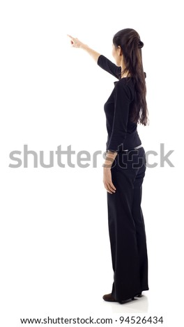 Asian business woman pointing at something in full length isolated over white background