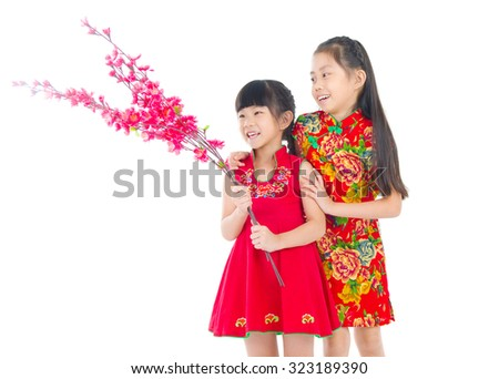 Asian Chinese girls decorating for Chinese new year