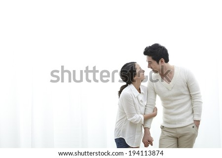 Asian couple holding hands - stock photo