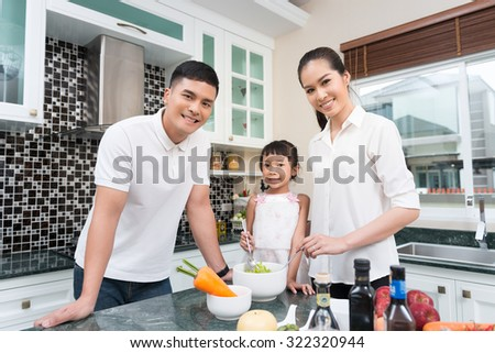 Asian family are cooking in the kitchen at home.  - stock photo