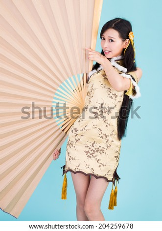Asian woman with oversize fan  happy Chinese new year - stock photo