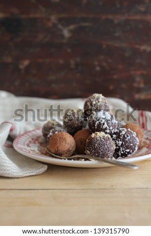 Assorted dark chocolate truffles with cocoa powder