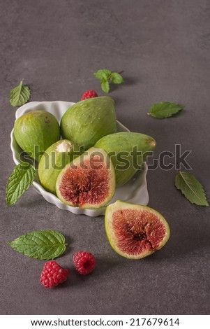 assorted fresh figs and raspberry - stock photo