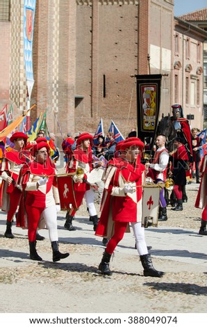 Asti, Italy - September 16, 2012: the historical Medieval parade of the Palio of Asti in Piedmont, Italy.  Trumpeter in medieval parade and flag-wavers of the districts