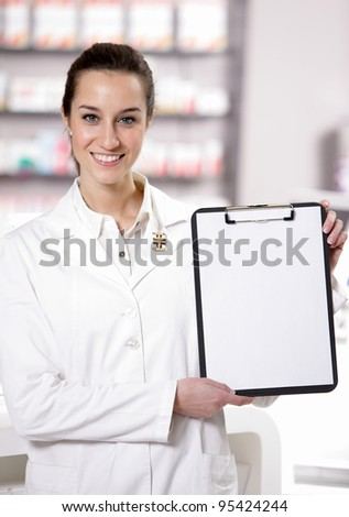 At pharmacy. Photo of an attractive young woman pharmacist with a clipboard. copy space - stock photo