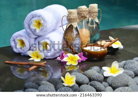 At the Spa, concept in a luxury Villa on Bali Island with, Massage oil, bath-salt, Volcanic stones, body scrub, Towels,Cinnamon sticks, Orchids and flowers.  - stock photo
